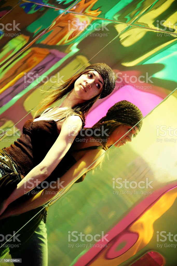 Young Woman Posing Against Mirrored Wall royalty-free stock photo