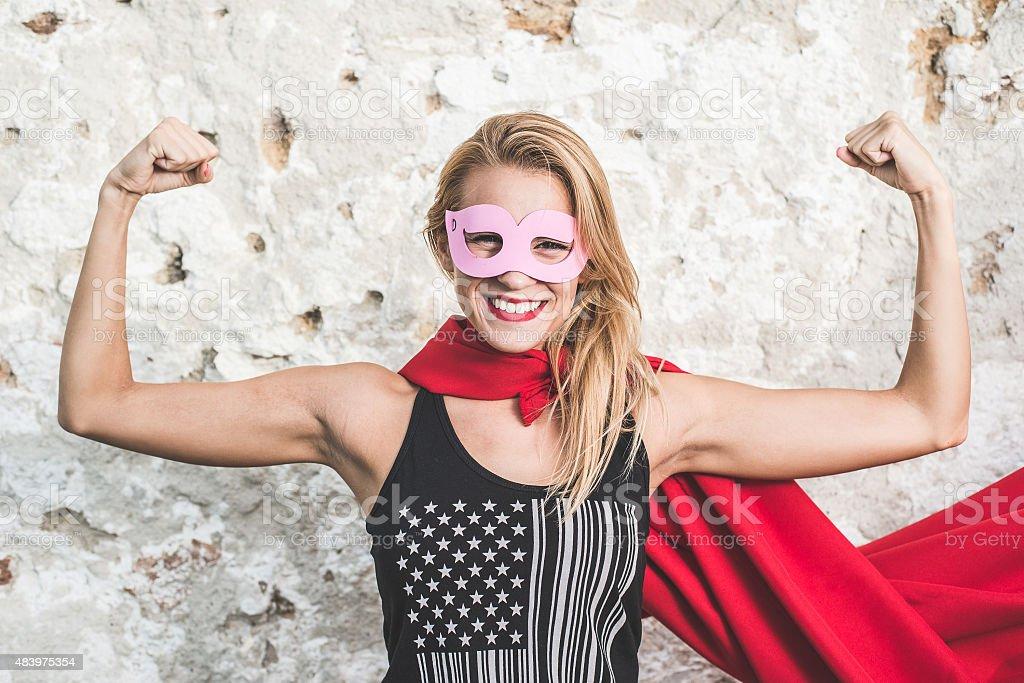 Young woman posing as superhero or superwoman stock photo