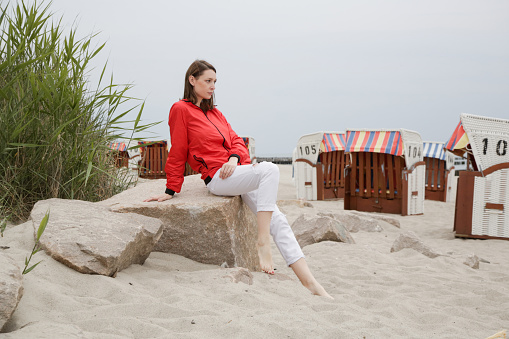 Young woman posing at the beach of Baltic sea