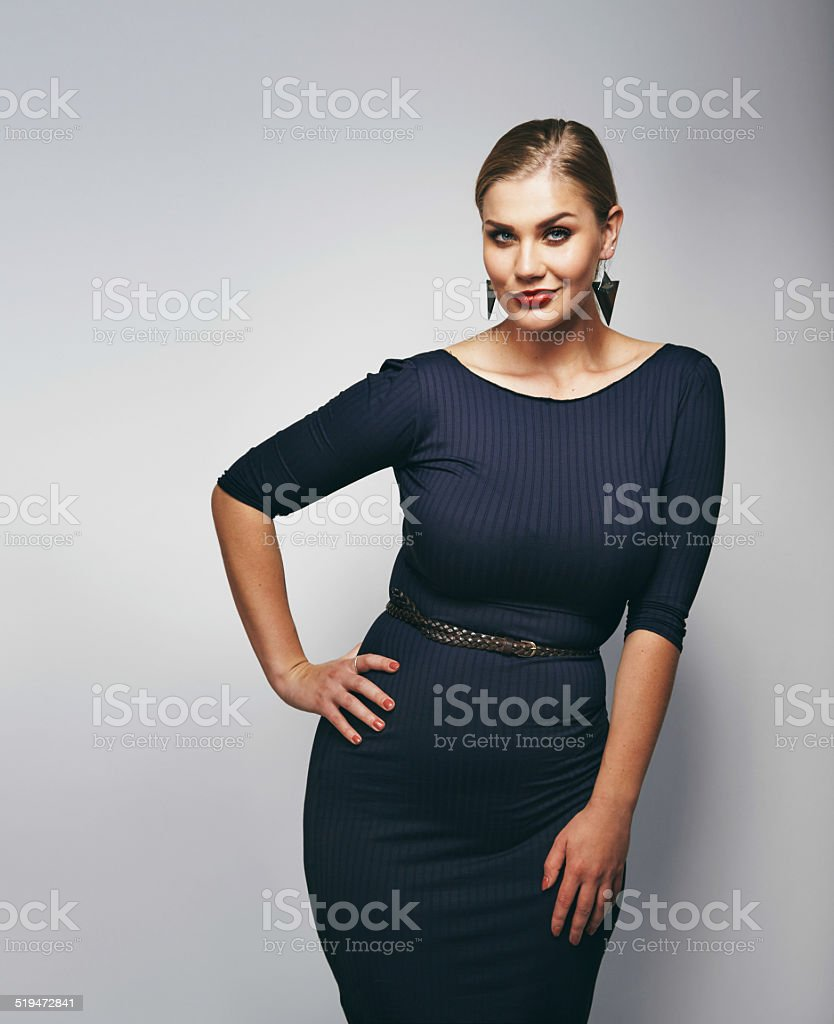 Chubby young woman posing confidently stock photo