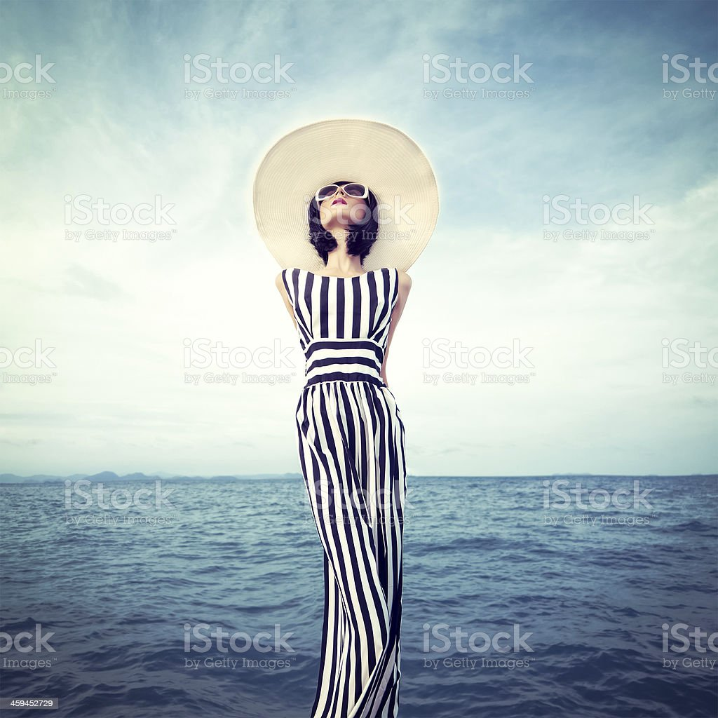 Young woman posing for photo shoot on beach royalty-free stock photo