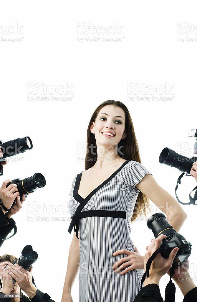 Young woman posing for the paparazzi's cameras royaltyfri bildbanksbilder
