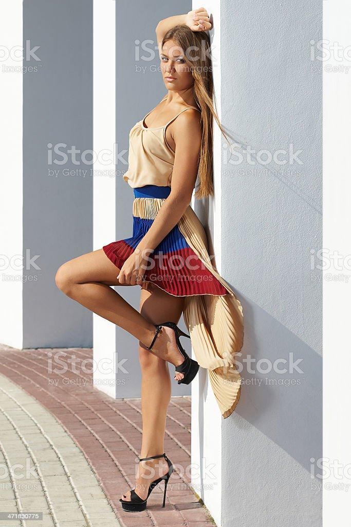 young  woman posing glamorously; fashion model stock photo