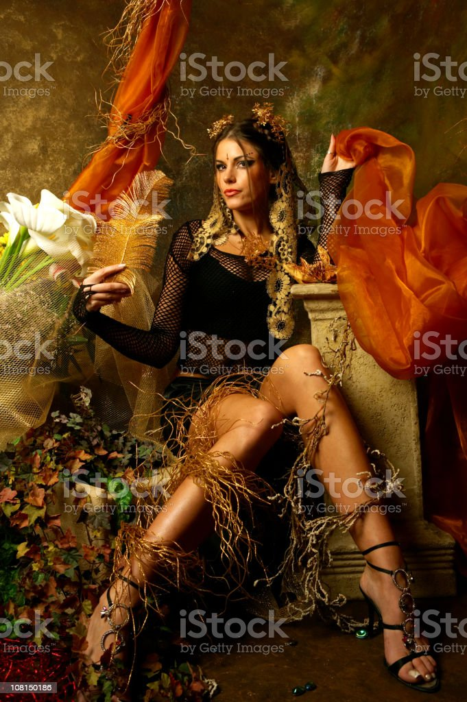 Young Woman Posing in Autumn Decorative Scene royalty-free stock photo