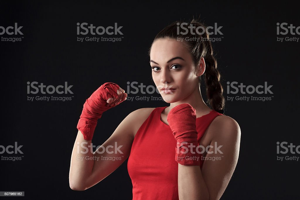 Young Woman posing in Boxing Outfit -braid hair stock photo