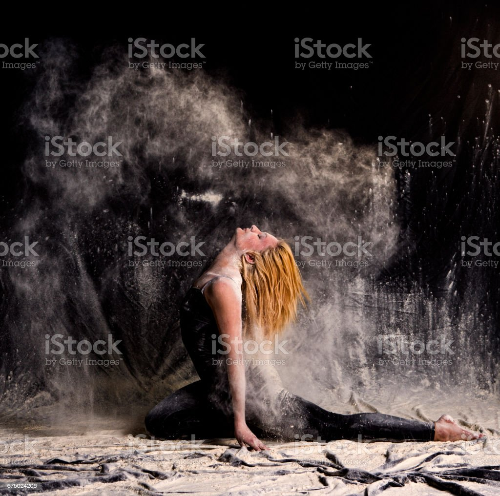Young woman posing in dust and powder in studio at istanbul turkey stock photo