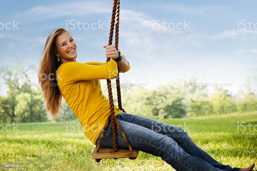 Young Woman Posing on a swing royalty-free stock photo