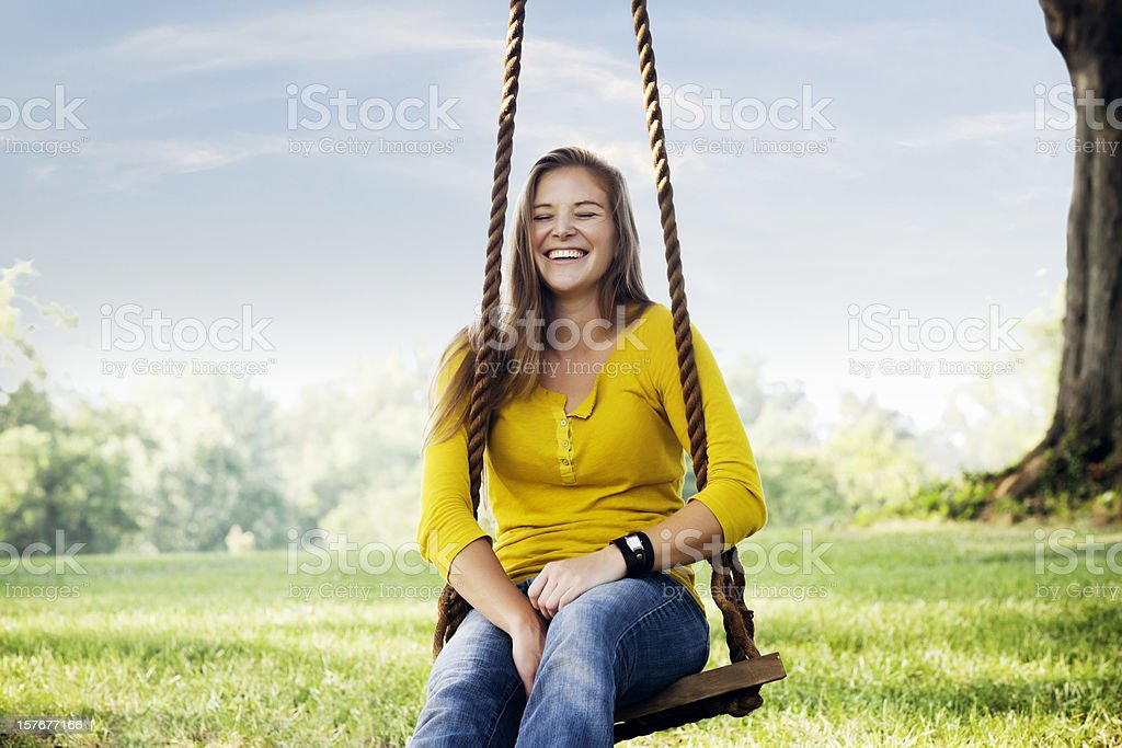 Young Woman Posing on a swing stock photo