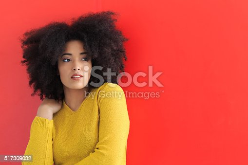 istock Young woman posing on red background 517309032