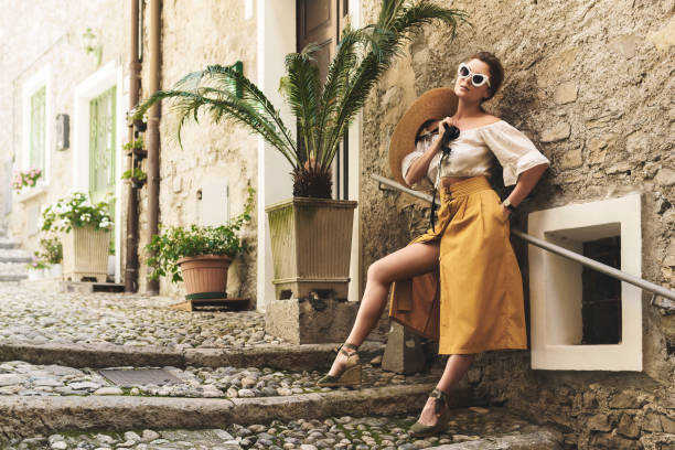 Young woman posing on the streets of small Italian town stock photo