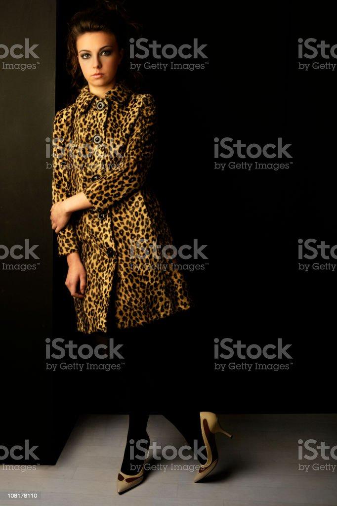 Young Woman Posing Wearing Leopard Fur Coat stock photo