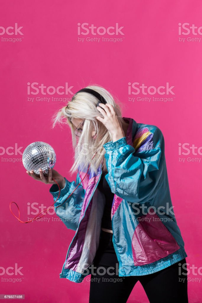 Young woman posing with a disco ball royalty-free stock photo