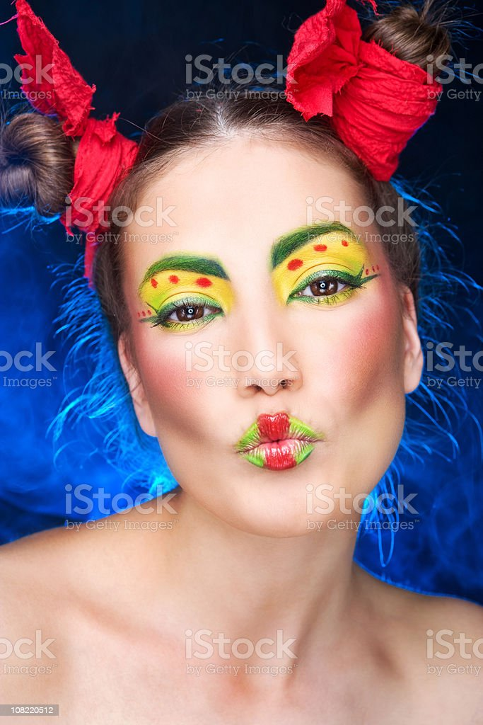 Young Woman Posing with Colorful and Bright Eye Make-Up royalty-free stock photo