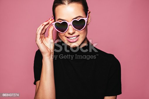 istock Young woman posing with glasses 663407274
