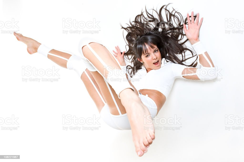 Young Woman Posing With Legs in Air Lying on Back royalty-free stock photo