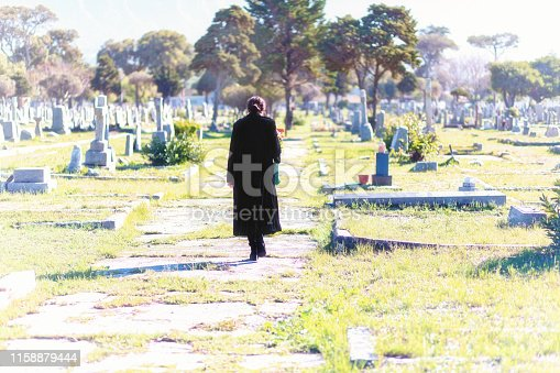 Young woman in a graveyard.
