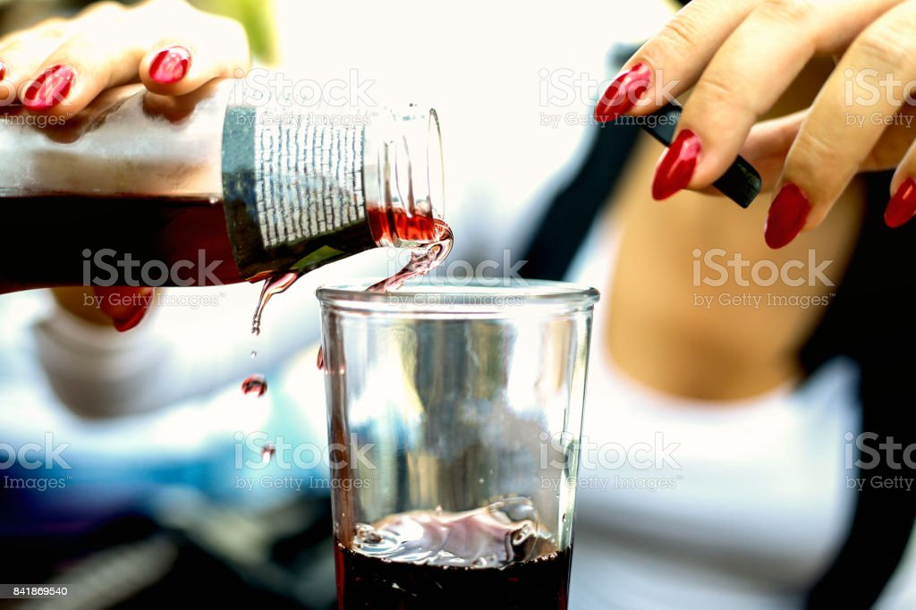 Young woman poured the juice into a glass stock photo