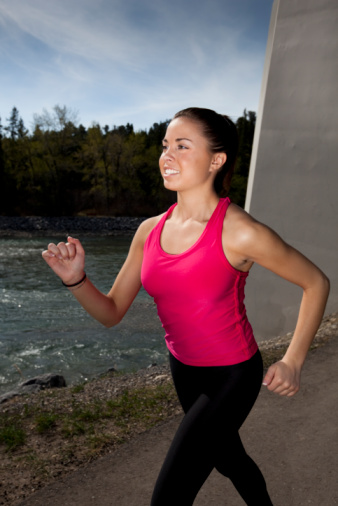 Young Woman Power Walking Stock Photo - Download Image Now