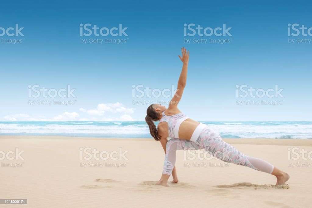 Young Woman Practice Yoga Posture Warrior Pose Virabhadrasana Stock Photo Download Image Now Istock