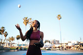 Young woman practicing baseball near Venice beach, California