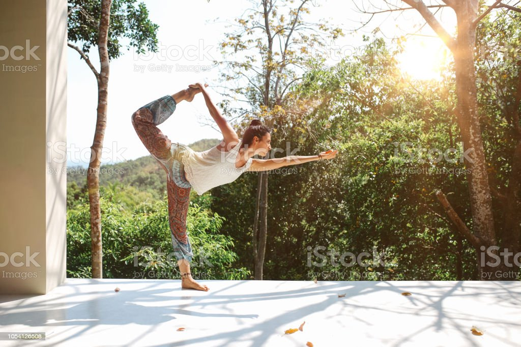 Young woman practicing Natarajasana  Lord of the dance pose in Thailand stock photo