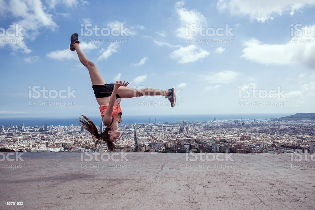 Young woman practicing parkour in the city of Barcelona stock photo