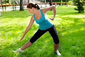 Young Woman Practicing Tai Chi in a park, outdoor