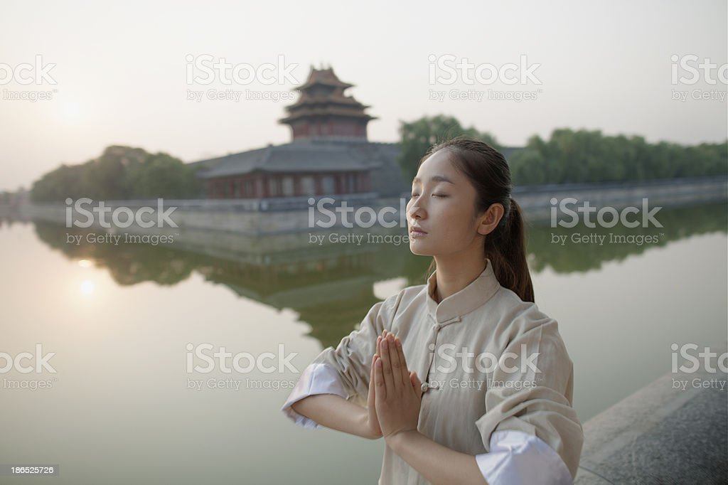 Young Woman Practicing Tai Ji royalty-free stock photo