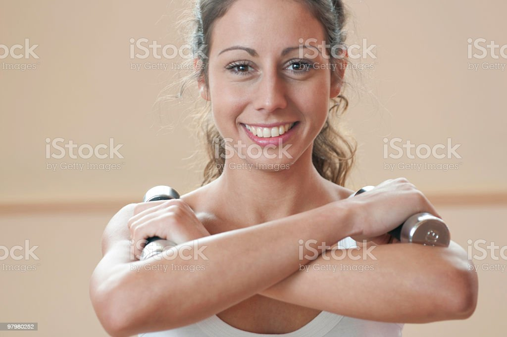 young woman practicing with Dumbbell royalty-free stock photo