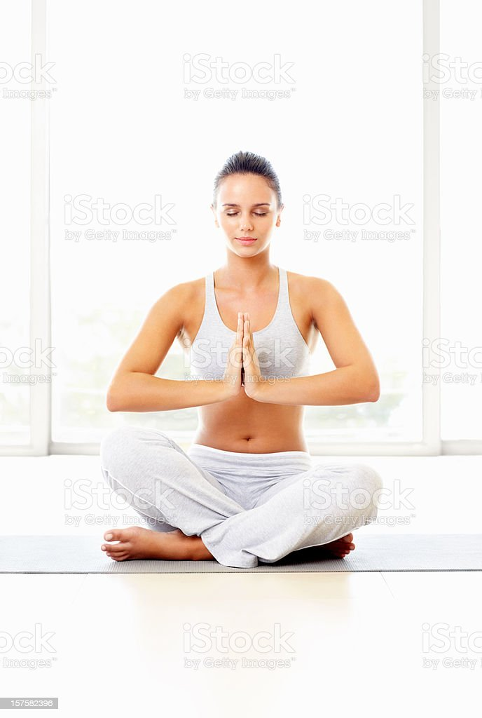 Young woman practicing yoga against bright background royalty-free stock photo