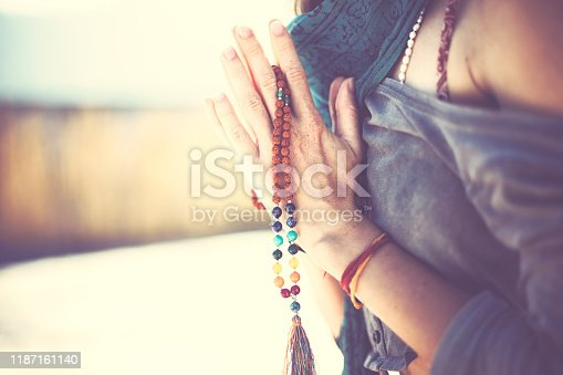 istock Young woman practicing yoga and meditation in sunshine of india 1187161140