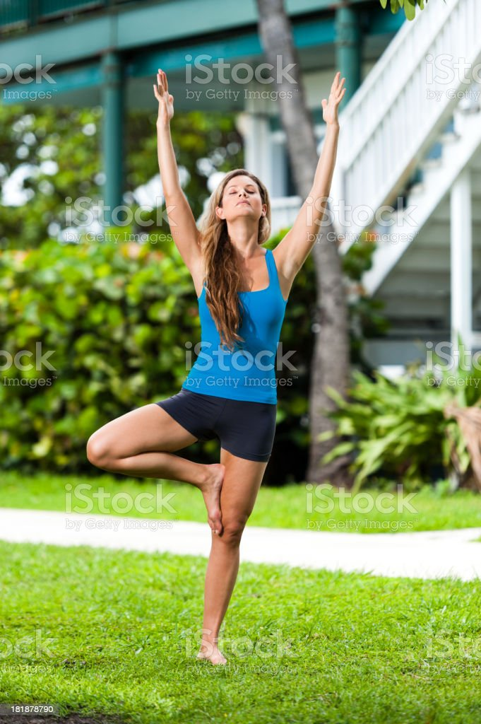 Young Woman Practicing Yoga in Tropical Environment royalty-free stock photo