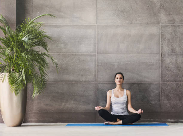 young woman practicing yoga. Meditation and harmony concept stock photo