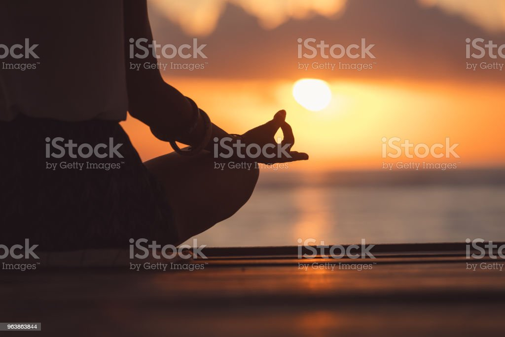Young woman practicing yoga on the beach. - Royalty-free Adult Stock Photo
