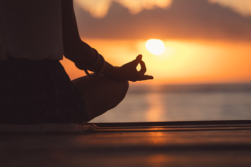 Young Woman Practicing Yoga On The Beach Stock Photo - Download Image Now
