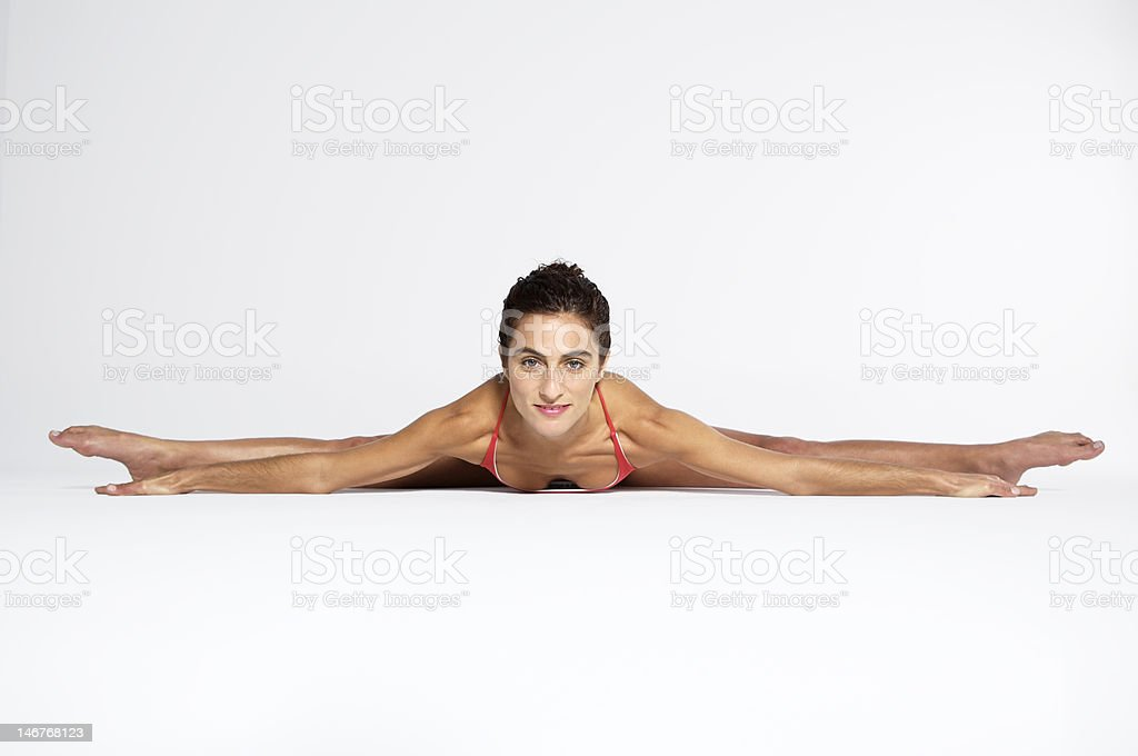 Young woman practicing yoga on the floor, portrait royalty-free stock photo