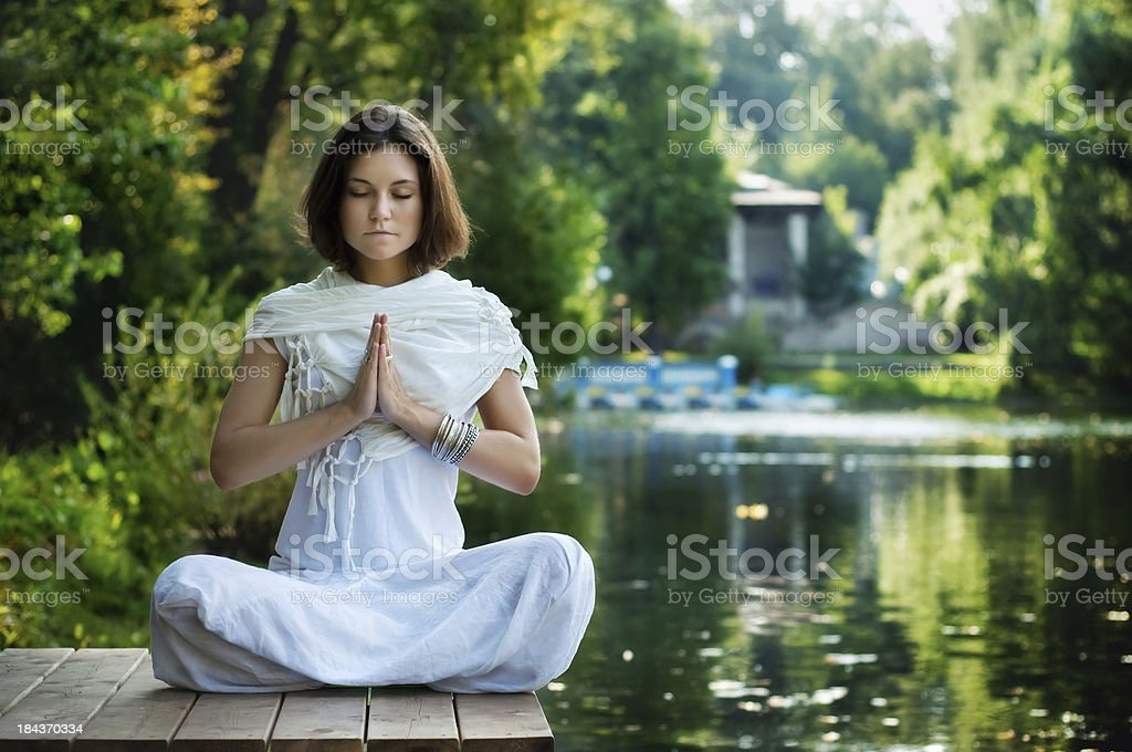 Young woman practicing yoga - Royalty-free Adult Stock Photo
