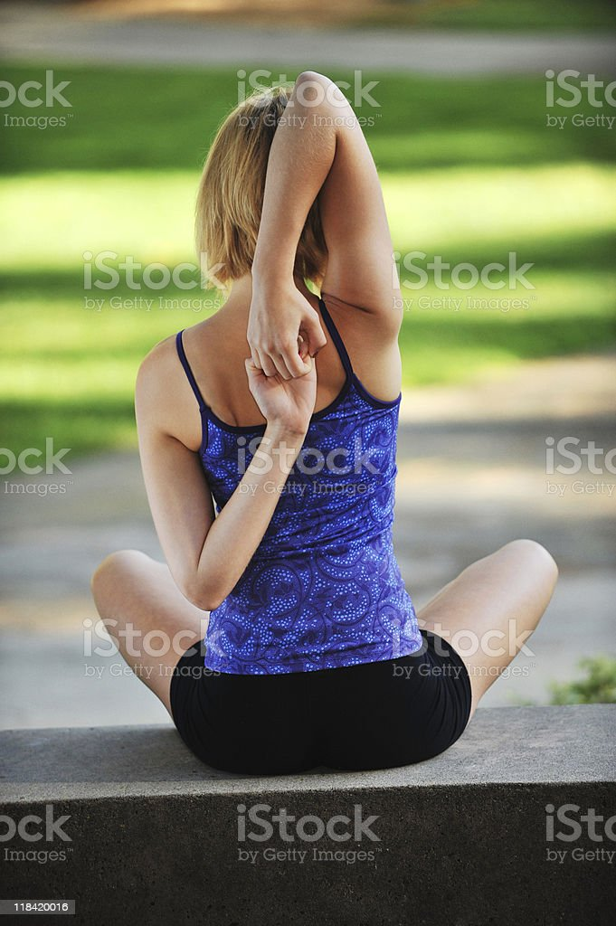 Young Woman Practicing Yoga Rear View royalty-free stock photo
