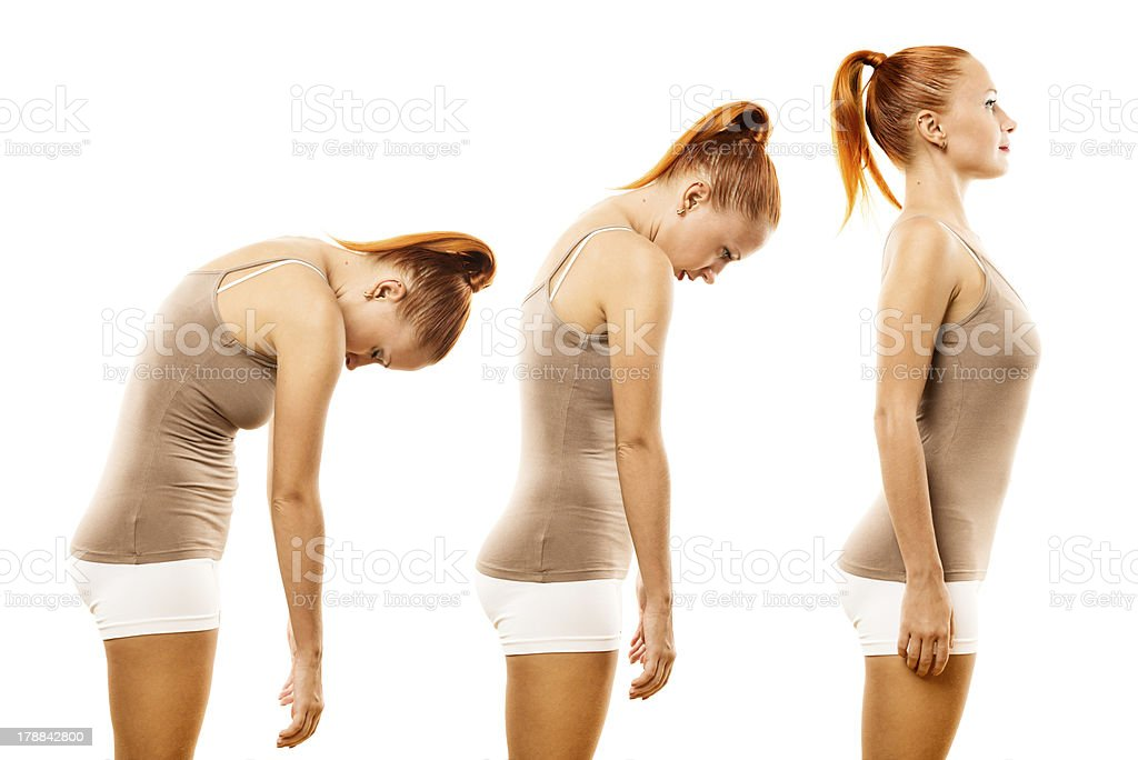 Young woman practicing yoga spine roll stock photo