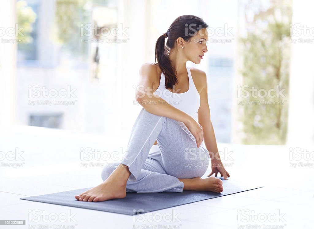 Young woman practising yoga exercise stock photo