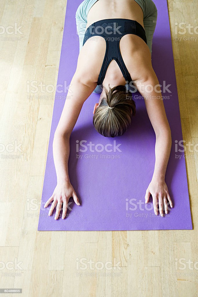 A young woman practising yoga royalty-free stock photo