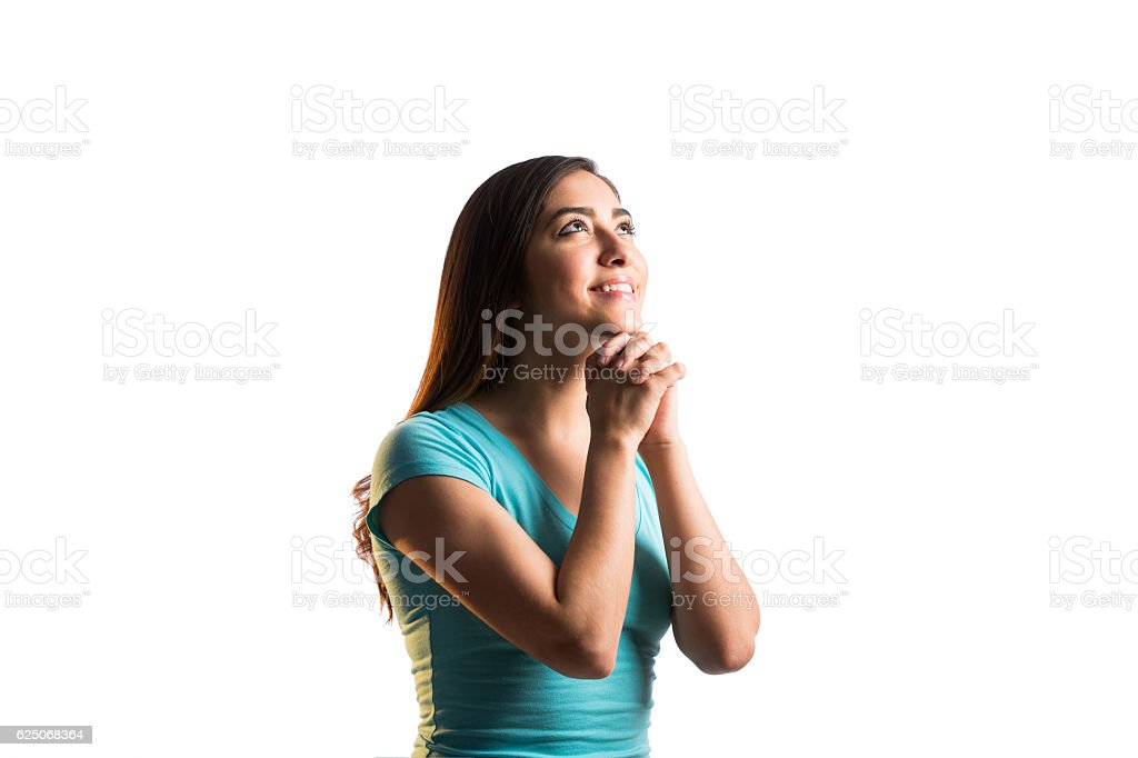 Young woman praying and smiling stock photo
