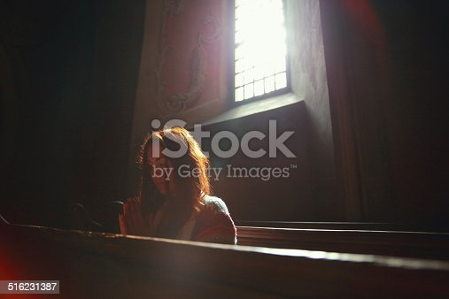 Young woman praying in church