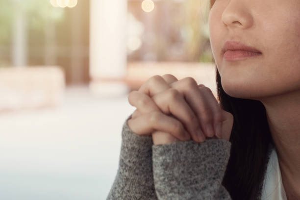 Young woman praying stock photo