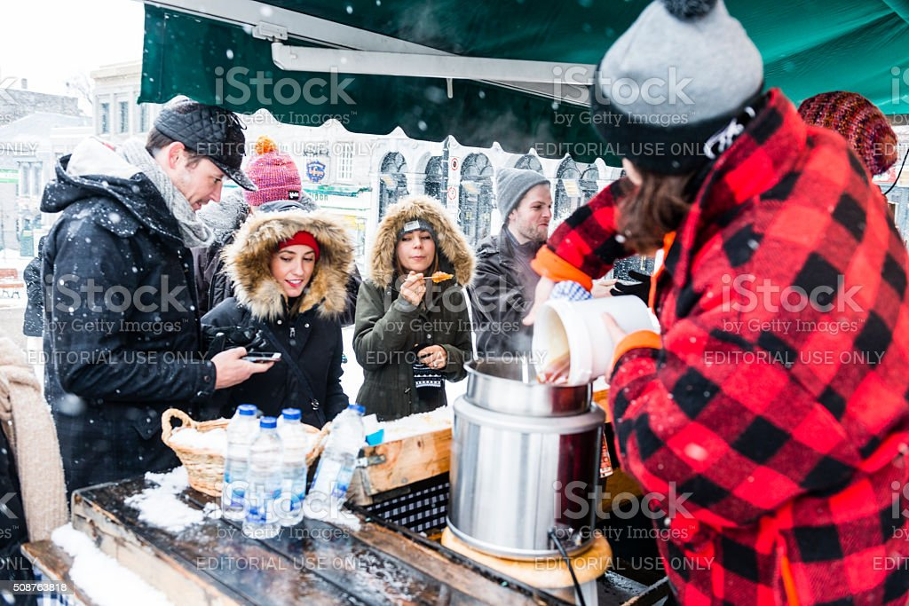 Young Woman Prepares Maple Syrup Treats in Montreal Canada stock photo