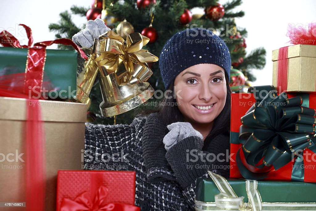 young woman preparing Christmas tree and gifts royalty-free stock photo