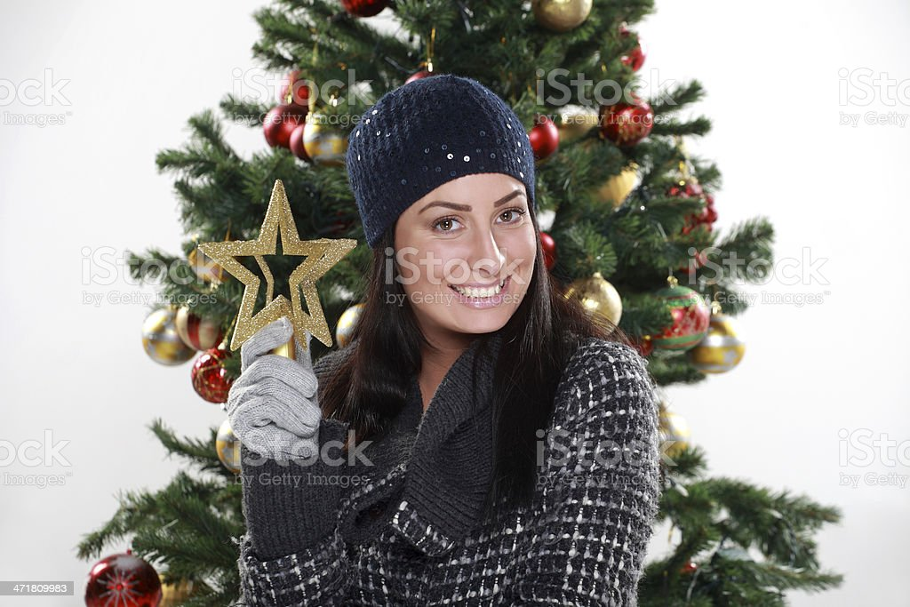 young woman preparing Christmas tree royalty-free stock photo