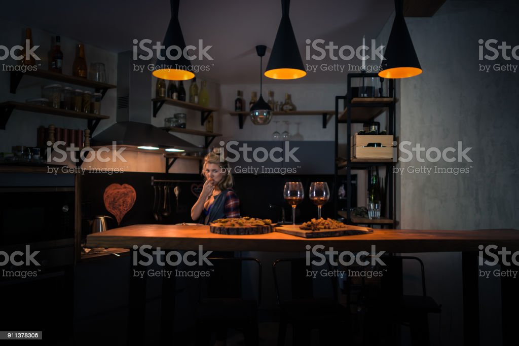 Young woman preparing dinner in the modern home kitchen stock photo