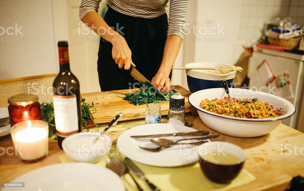 Young woman preparing food on the table - foto de acervo