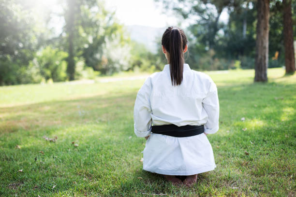 Young woman preparing for karate stock photo